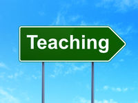 Education concept: Teaching on road sign background
