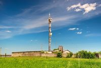 TV tower on green field