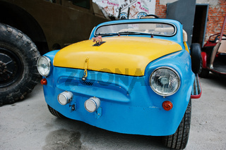 Podol, Ukraine - May 19, 2016: Handmade blue and yellow bicolor vintage retro classic car based on ZAZ automobile.