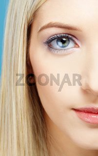 blonde girl's half-face portrait