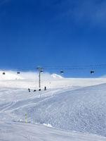 Gondola lift and snowy ski slope in fog