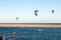 Jose Ignacio, Uruguay, Kiters on the Garzon Bay are using last summer days