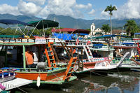 Tourist boats waiting for tourists near the Church Igreja de Santa Rita de Cassia in Paraty state Rio de Janeiro