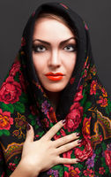 young woman in a headscarf in the Russian style.