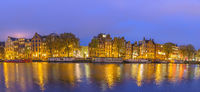 Amsterdam sunset panorama city skyline at canal waterfront, Amsterdam, Netherlands