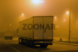 carriage of goods by road, trucking industry - overweight vehicle, foggy night road