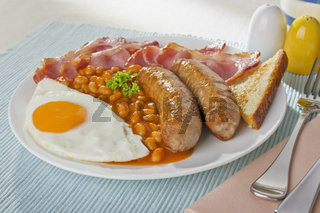 English Breakfast of Bacon, Egg, Baked Beans and Sausage