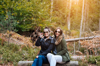 two beautiful girls sat down in the forest