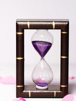 Hourglass on white background - close up photo