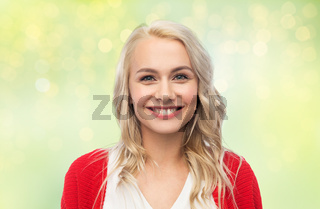 happy smiling young woman in red cardigan