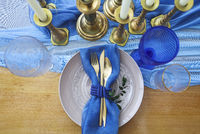 Table setting in vintage style is decorated with candles