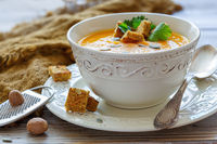 Pumpkin soup with croutons and spices.