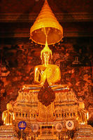 Statue of a golden Buddha inside a temple