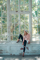 girl sitting on window