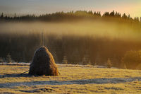 haystack in mountain rural area