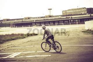 teenage boy riding his bike, vintage version