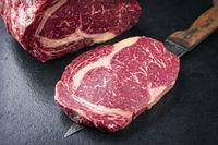 Raw dry aged Kobe Entrecote Steak as close-up on a slate