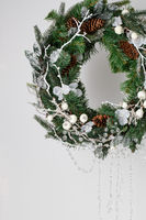 Christmas wreath of spruce with cones