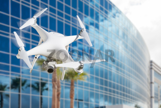Unmanned Aircraft System (UAS) Quadcopter Drone In The Air Near Corporate Building.