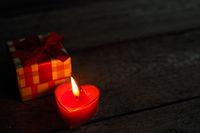Heart shaped candle burning