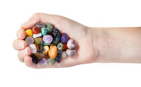 top view of handful with various gems isolated