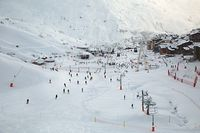 Skiing slopes, with many people