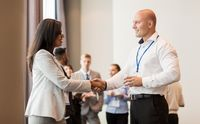handshake of people at business conference