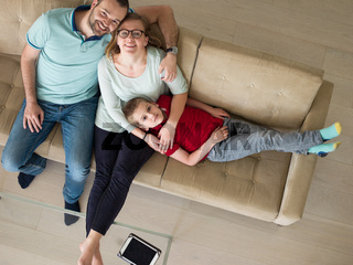 family with little boy enjoys in the modern living room