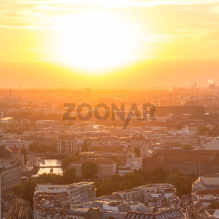 Panoramic aerial view over Berlin in romantic colorful sunset.