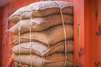 Jute sacks stacked in a warehouse
