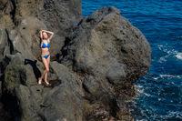 beautiful girl resting in natural ocean swimming pool