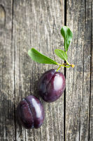 Two fresh plums.
