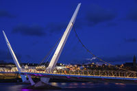 Full moon rising by Peace Bridge in Derry