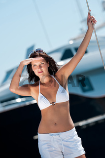 Attractive young woman in bikini on sunny day