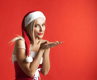 Santa claus girl blowing kiss