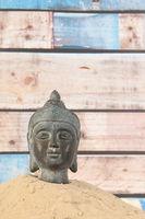 Buddha in sand