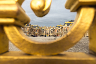 The golden gate of the Palace of Versailles, or Chateau de Versailles, or simply Versailles, in France