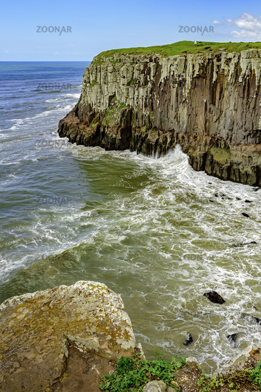 Cliff over ocean and waves