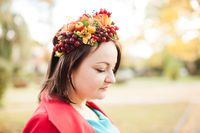 Woman with autumn wreath