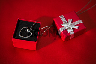 Silver heart pendant in a red gift box