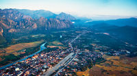 Aerial view of a small town in rocky mountain valley and river