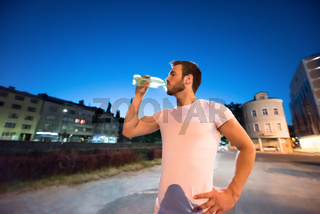 man drinking water after running session