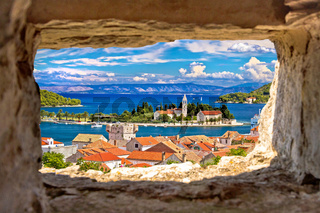 Vis bay waterfront view through stone window