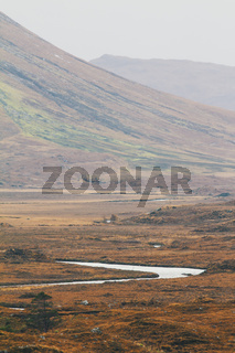 Mount landscape with river - view of highland in Scotland, autumn