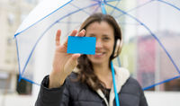 Purchase, Payment, woman with bank card in hand, brunette in the street with an umbrella that goes shopping