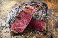 Barbecue aged Wagyu Rib Eye Steak as close-up on a wooden board