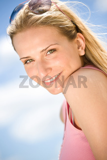 Portrait of blond woman with summer sky