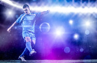 soccer player in front of big modern stadium with flares and lights
