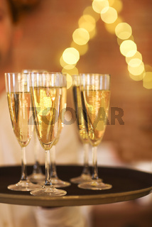 Champagne glasses on tray. Party and event concept