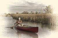afternoon canoe paddling on  a lake